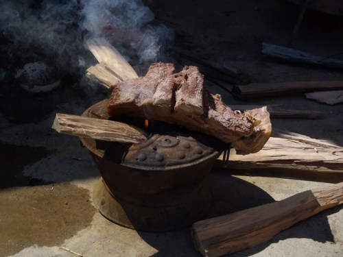 Burning off the hair from the pipa-meat. After this it's soaked to remove the salt, cooked and chopped.